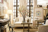 This showroom space may be cluttered, but I love how the neutral palette and the blossom branches mimic the subtle floral pattern in the fabric.
