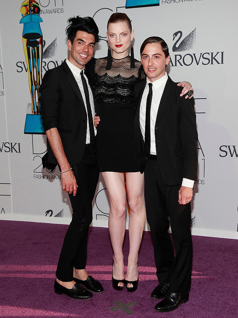 Keegan Singh, Guinevere van Seenus in vintage James Galanos and Eddie Borgo jewels, with Eddie Borgo