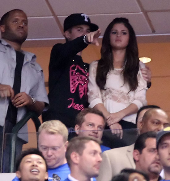 Justin Bieber and Selena Gomez Cozy Up at a Basketball Game!