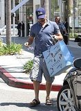 Leonardo DiCaprio Leaves Lanvin Carrying Armloads of Gifts For One Lucky Lady
