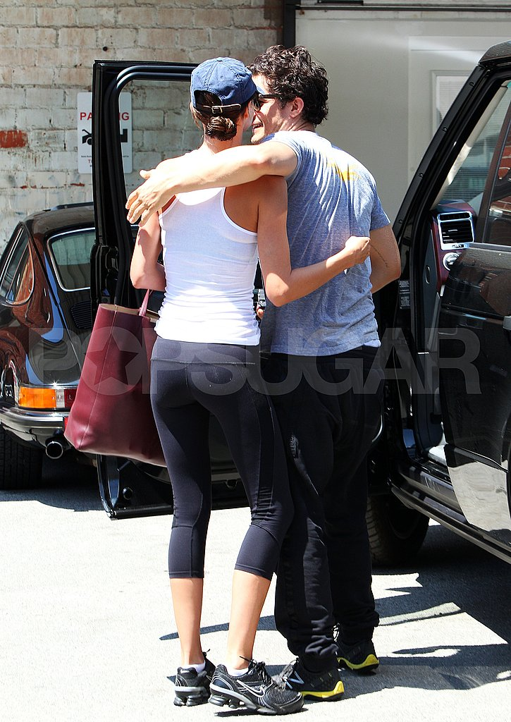 Orlando Bloom and his wife Miranda Kerr joke after a workout.