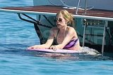 Avril Lavigne swimming in a bikini.