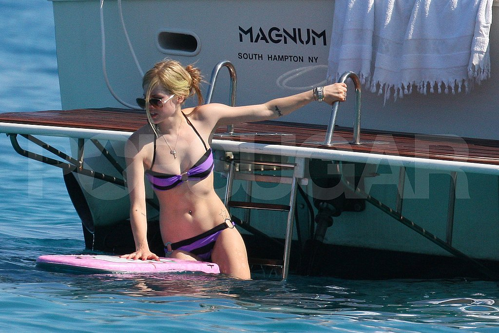 Avril Lavigne on a body board.