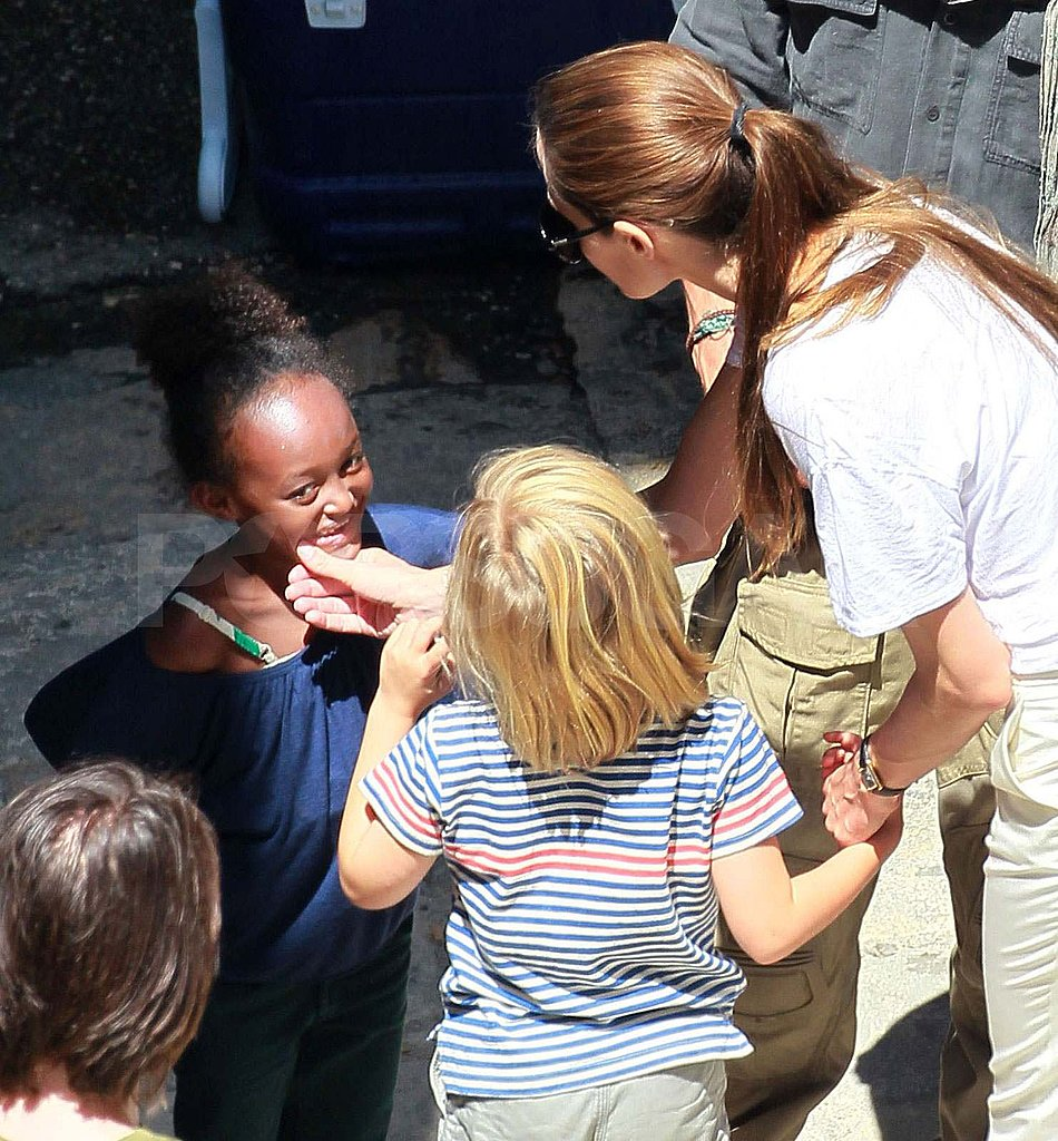 Angelina Jolie held onto Shiloh's hand.