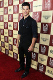 Taylor Lautner stuck a pose on the red carpet.