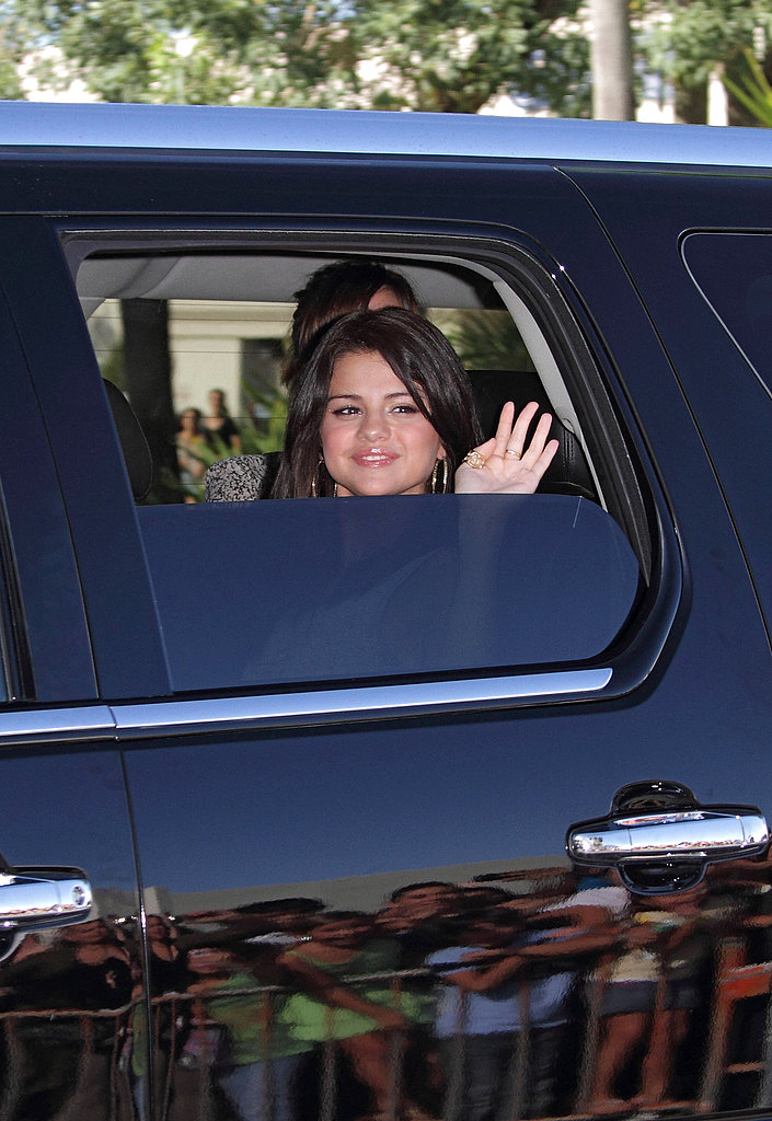 Selena Gomez hopped in the back of a black SUV.