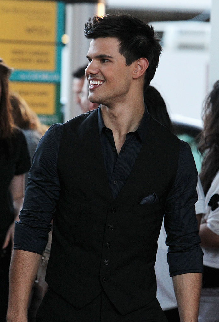 Taylor Lautner smiled at fans during the LA Film Festival.