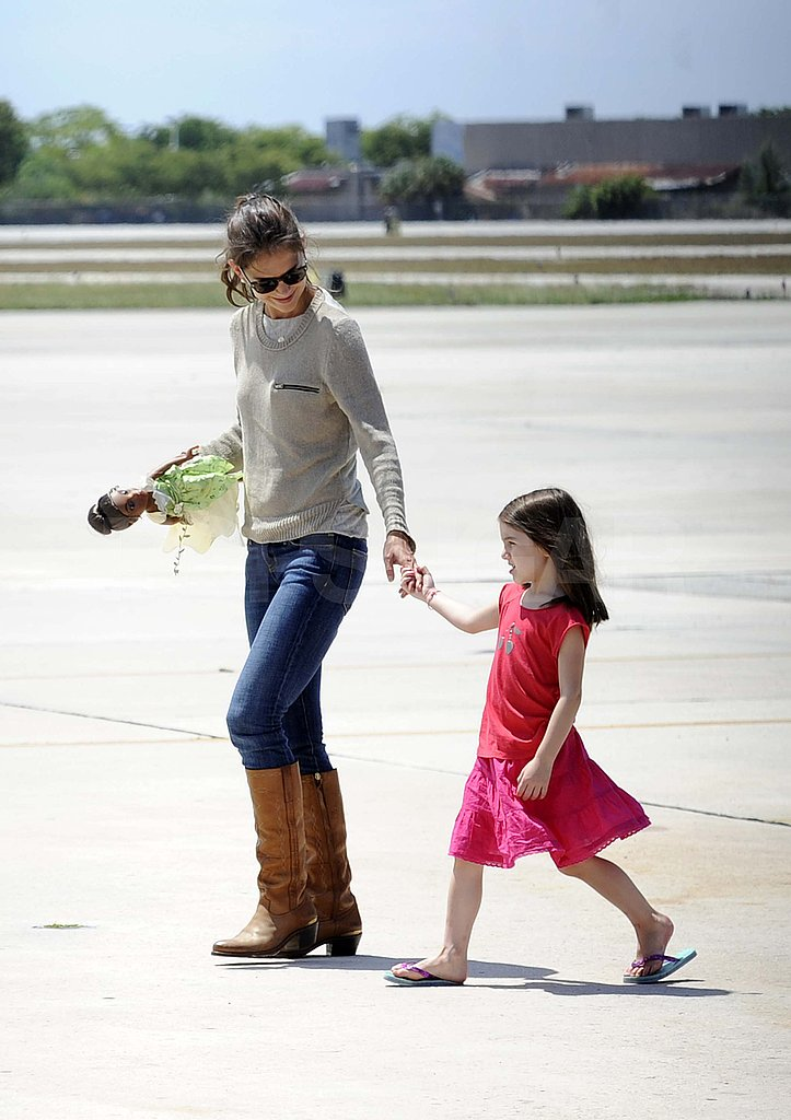 Suri held onto her mom's hand in Miami.
