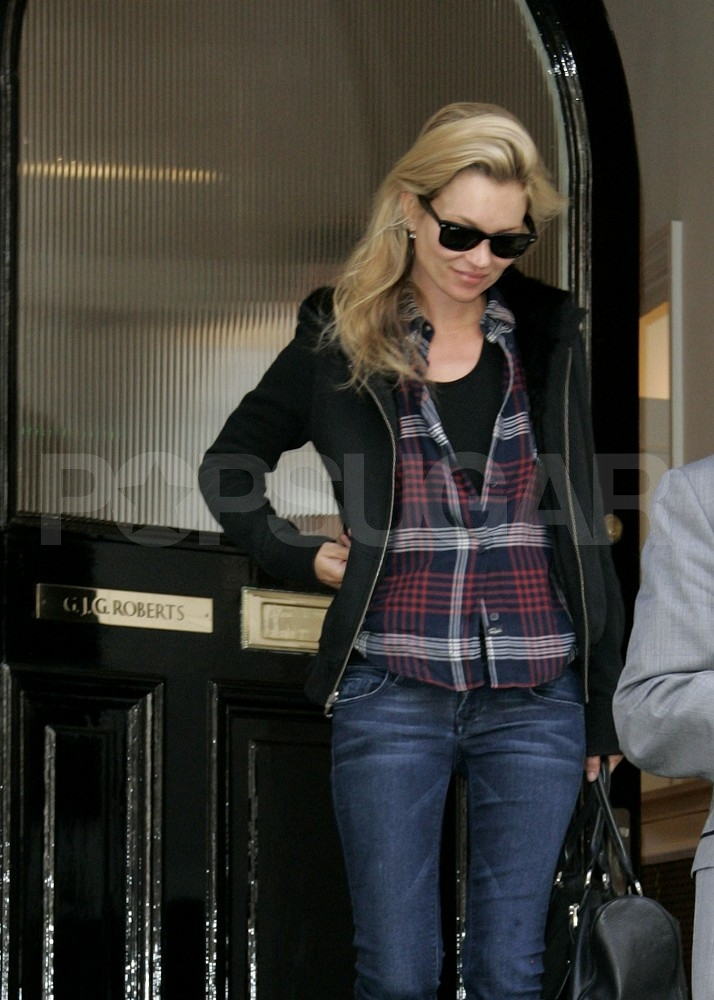 Kate Moss in Ray-Ban Wayfarer sunglasses.