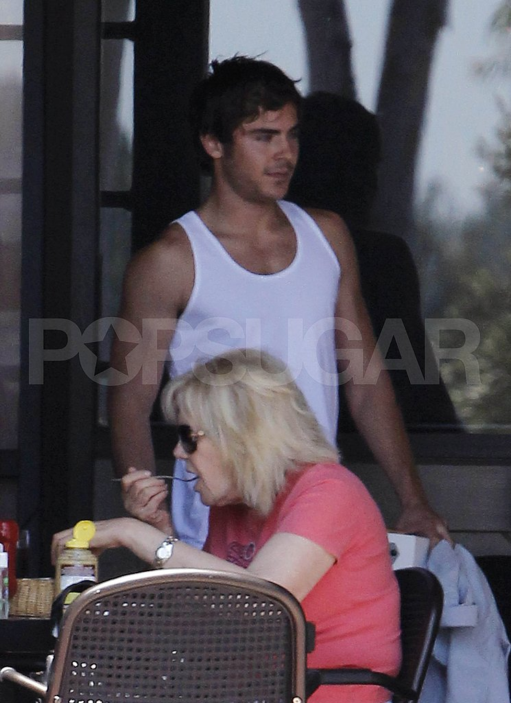 Zac Efron wore a white tank top.