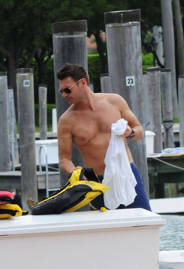 Ryan Seacrest went shirtless before strapping on his life vest.