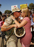 A Marine fresh from Iraq plants a kiss on his wife in 2003.
