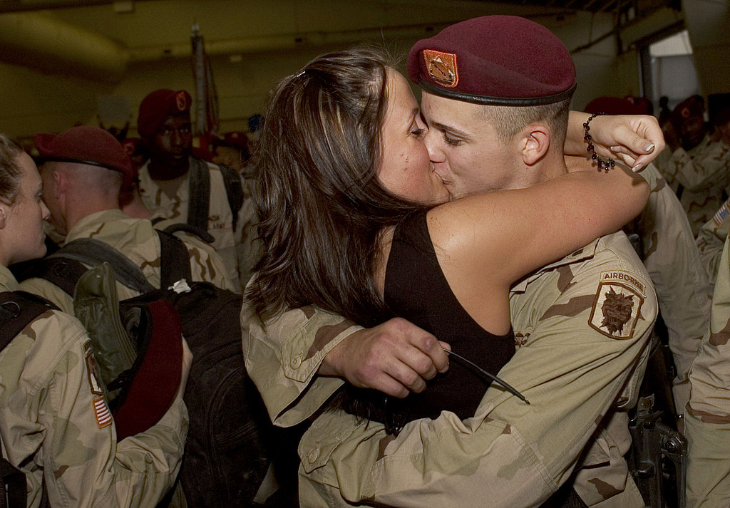 Jennifer Chapman embraces her husband, Dustin Chapman, with a kiss upon his return from Iraq on Nov. 9, 2005 in Fort Bragg, NC.