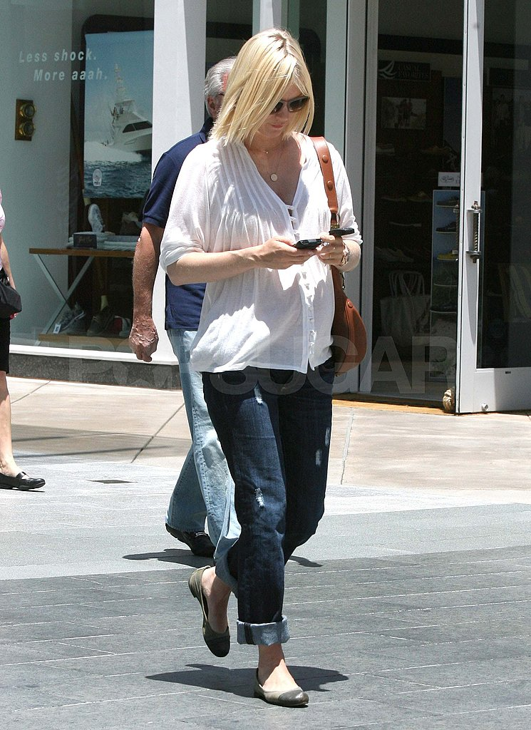 January Jones covered her baby bump with a white shirt.