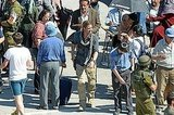 Brad Pitt walked across the set of World War Z in Malta.