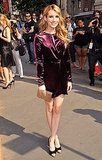 Emma Roberts wore purple to the Salvatore Ferragamo resort show in NYC.