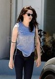 Kristen Stewart wore a gray top and black jeans.