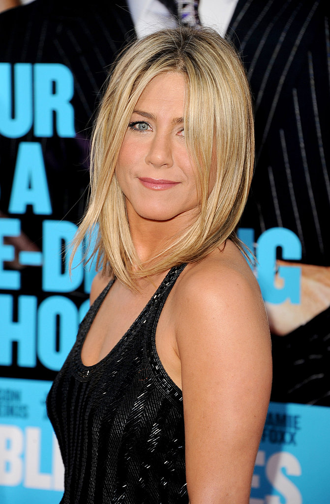 Jennifer Aniston's blonde hair fell perfectly around her face.