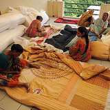 Indian women work on handmade quilts.