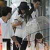 Katie Holmes and Suri Cruise in the Rain in Miami Beach