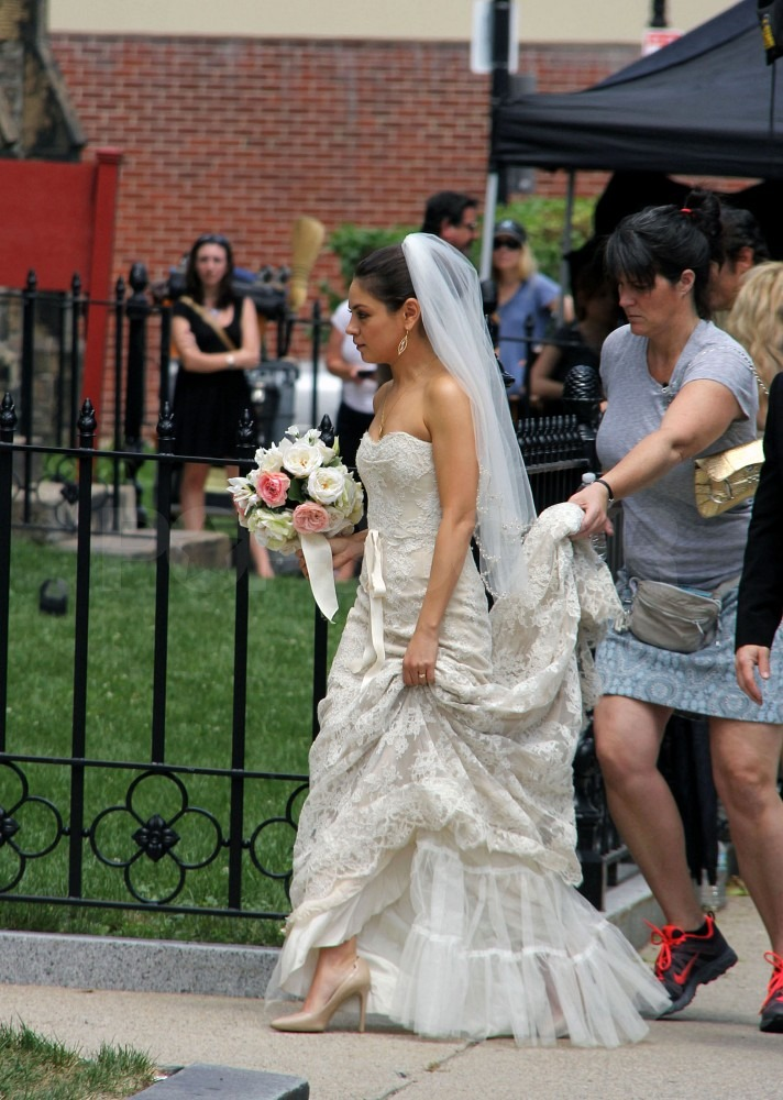 Mila Kunis had help with her wedding dress.