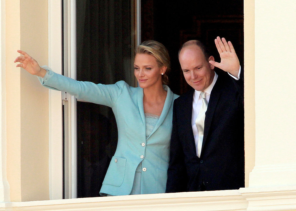 Princess Charlene of Monaco and Prince Albert II of Monaco wave to onlookers.