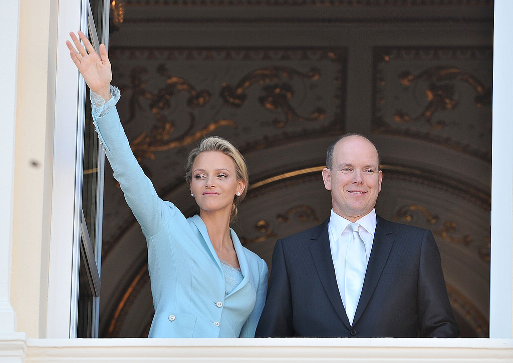 Princess Charlene of Monaco waves with husband Prince Albert II of Monaco by her side.