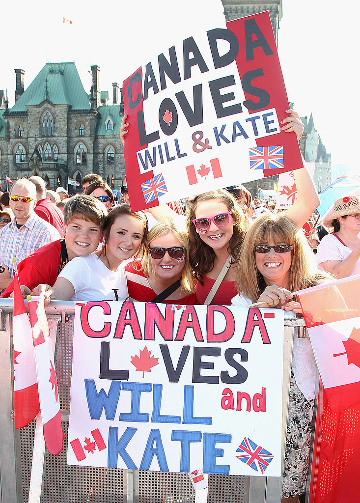 Royal fans wait to catch a glimpse of Prince William, Duke of Cambridge, and Catherine, Duchess of Cambridge, at Canada's Parliament Hill.