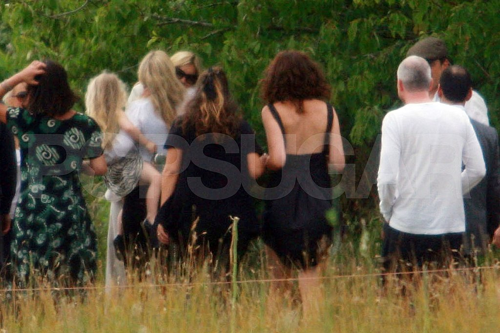 Kate Moss hugs friends after her wedding.