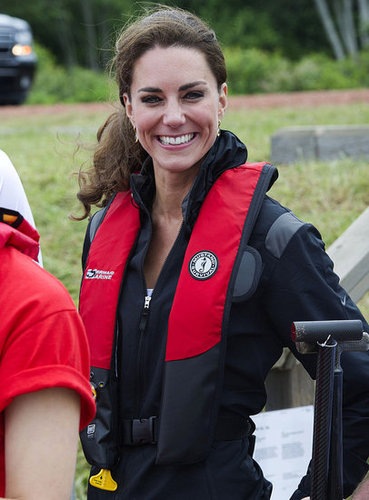 Kate Middleton flashed a smile on July 4 as she and Prince William competed in a dragon boat race.