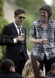 Jamie Hince laughs with friends after marrying Kate Moss.