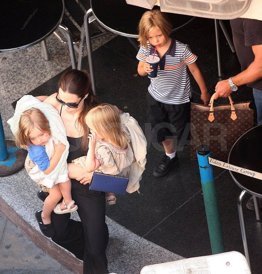 Angelina Jolie Has the Twins in Her Arms and Shiloh by Her Side For Another Bowling Day