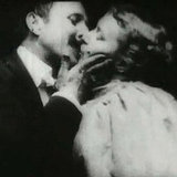 The first motion picture kiss was in Thomas Edison's 1896 film The Kiss between John C. Rice and May Irwin.