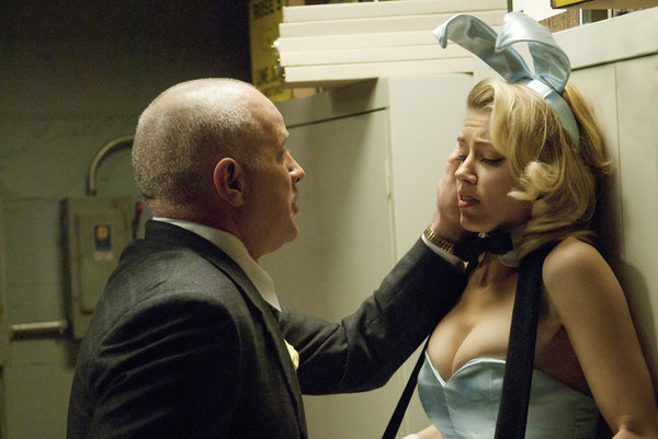 Randy Steinmeyer as Clyde Hill and Amber Heard as Maureen on NBC&#039;s The Playboy Club.