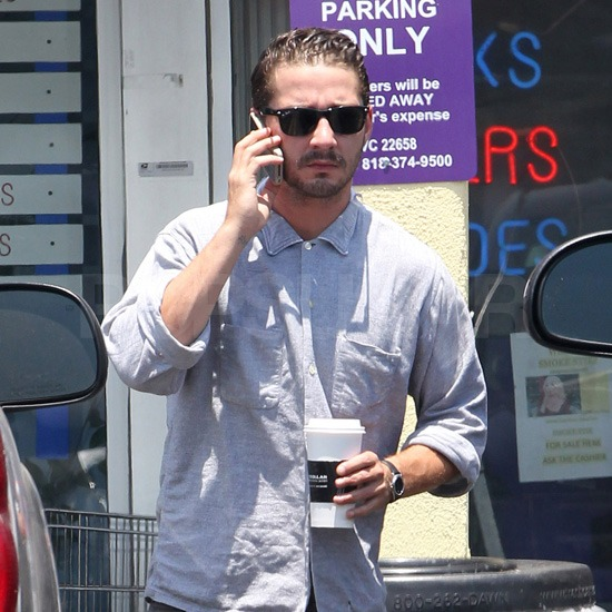 Shia LaBeouf chatted on his phone and sipped a coffee.