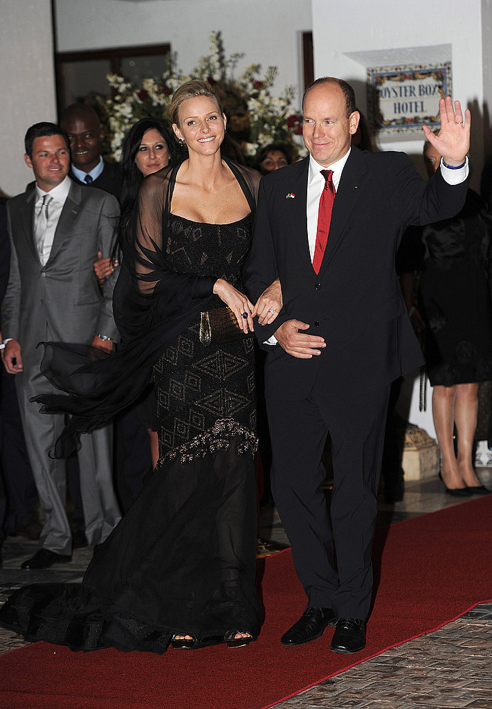 Princess Charlene linked arms with Prince Albert.