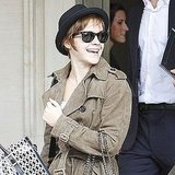 Emma Watson was all smiles arriving at Heathrow.