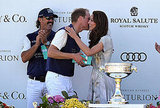 Prince William and Kate Middleton kiss at polo match.