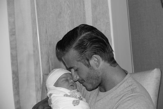 David Beckham nuzzled in close to baby Harper Seven.