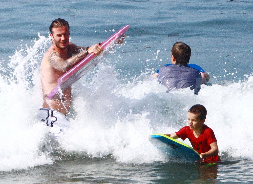 David Beckham shirtless in the ocean.