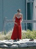 Pregnant Victoria Beckham in a red dress in Malibu.