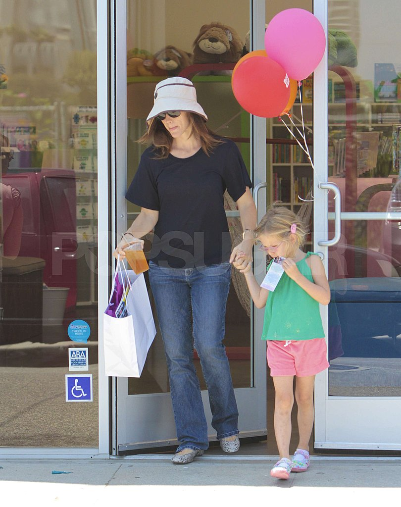Violet held her mom Jennifer Garner's hand on the way out.