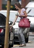 Pippa Middleton opens her car door.