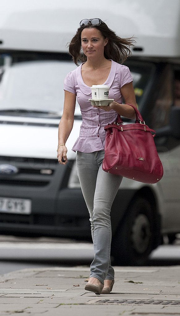 Pippa Middleton in a pink shirt and with a pink bag.