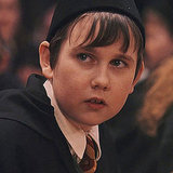 Matthew Lewis said he wore a fat suit, fake teeth, and plastic to make his ears stick out in the early films. Here's Neville in all his misfit glory in Harry Potter and the Sorcerer's Stone.