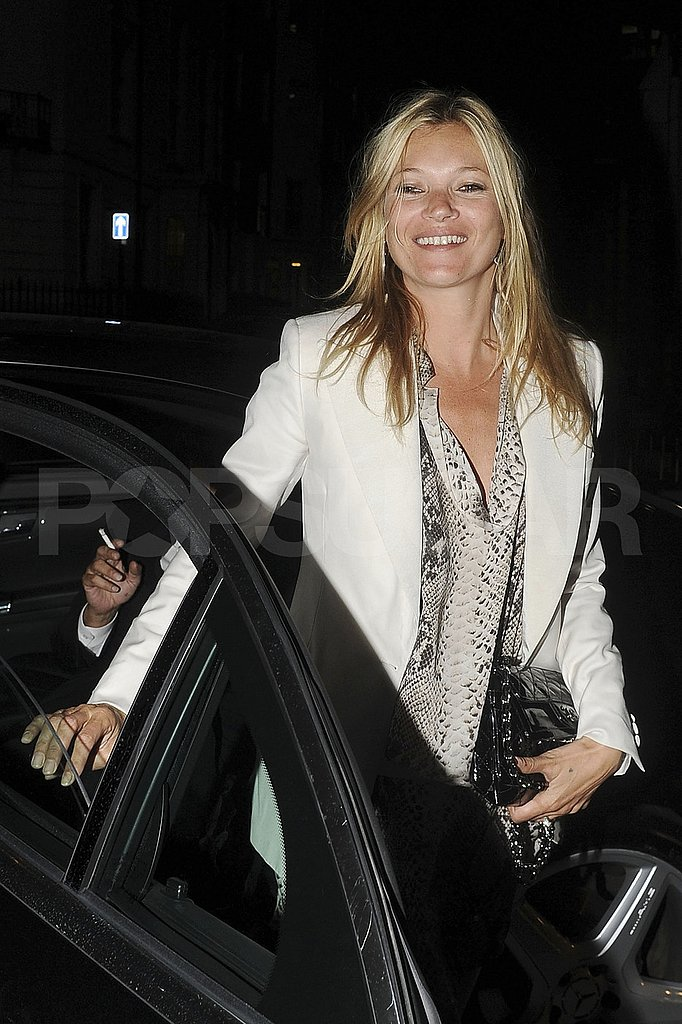 Newlywed Kate Moss smiles.