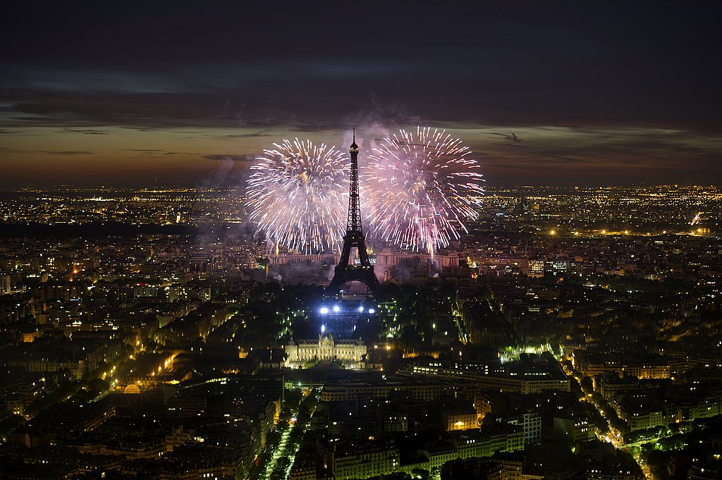 Bastille Day fireworks burst over the Eiffel Tower.