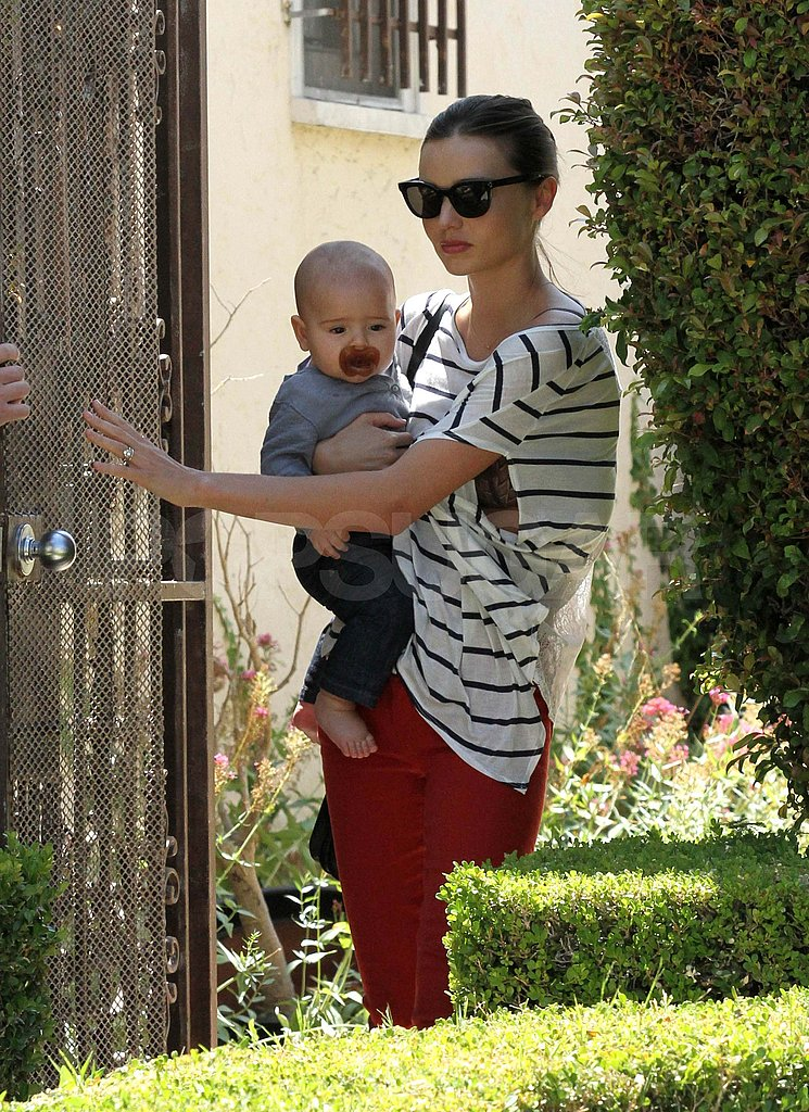 Miranda Kerr carried Flynn Bloom on her hip.
