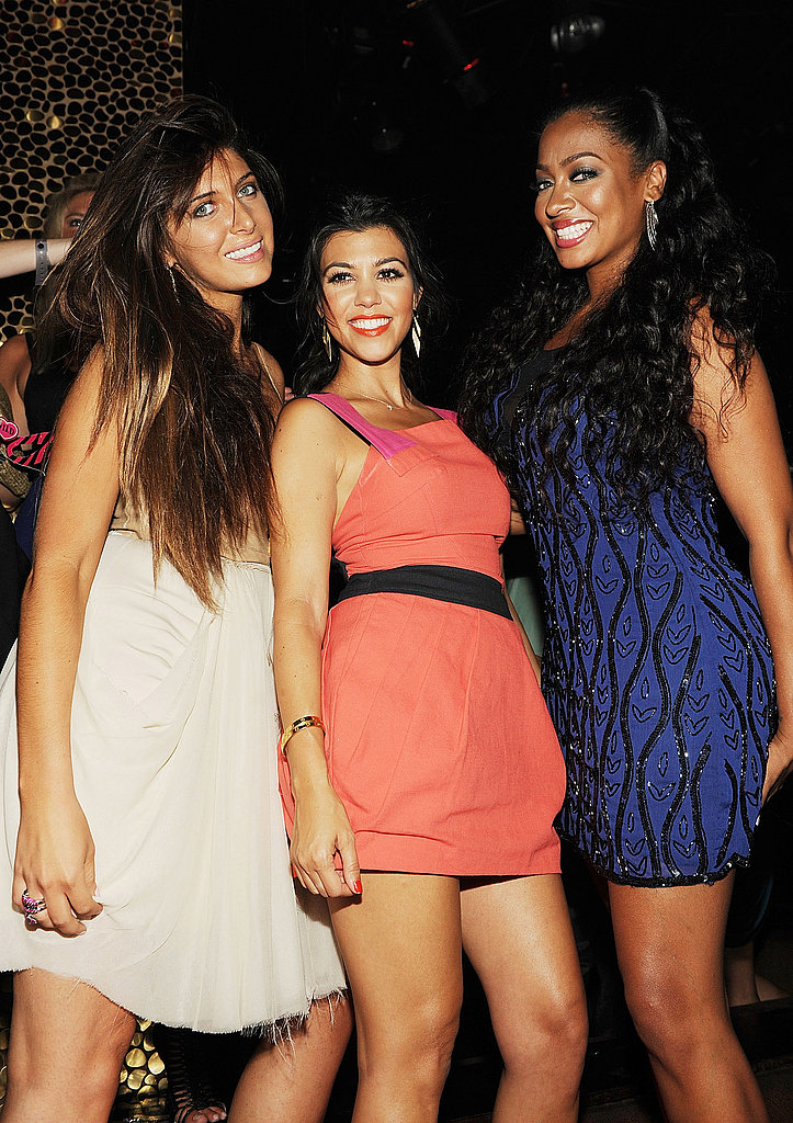 Kourtney Kardashian wore a bright coral dress to the bash.