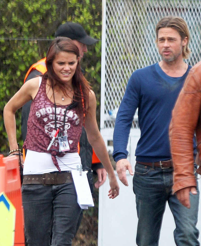 Brad Pitt walked with a crew member to the set in Rome.
